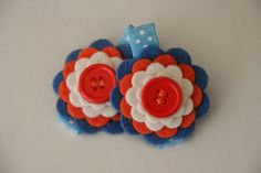 Baby Hair Clips in Wool Felt Orange and Blue Flowers Toddler Hair Clips Girls Hair Clips. $7.99, via Etsy.