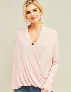 7679b6d2586 A soft pink waffle-knit nursing friendly surplice top featuring long  sleeves and a draped