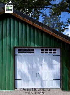 This carriage house door really looks great on this pole barn. It rolls up just like a garage door, but comes with 4 hinges and outside handles. This particular door also has lites in the top panel letting in additional daylight. Pole Barn Builders, Garage Builders, Pole Barn Homes, Pole Barns, Building A Pole Barn, Building Front, Metal Building Homes, Building A House, Pole Buildings