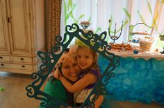 Little Mermaid's Sweets Under The Sea Party - I bought this cheap frame at Michael's and painted it to match the party. Throw in some party dress-up clothes and you've got a photo booth of sorts. Love me and my birthday girl!!