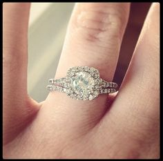 A glittering softened halo of pavé-set diamonds surrounds the center diamond in this elegant matched set.