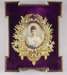 Fabergé violet guilloché sunburst enamel and gold frame with miniature of Tsarina Marie Feodorovna. Workmaster Michael Perchin. Acquired by the Prince and Princess of Wales (later King Edward VII and Queen Alexandra), c.1895.