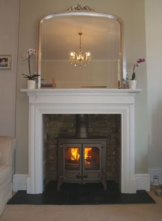 MDF mantel with reclaimed brick slip chamber, natural slate tiled hearth and bronze Charnwood Island 2 multi fuel stove. Fitted in westcliff on Sea Essex 2008 1930s Fireplace, Wood Burner Fireplace, Fireplace Design, Fireplace Mantels, Fireplaces, Fireplace Ideas, Vintage Fireplace, Fireplace Mirror, Log Burner Living Room