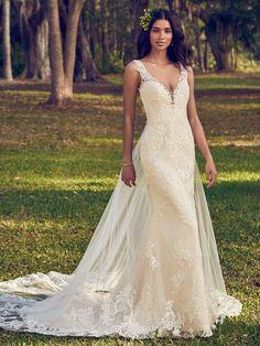 Bernadine| Sheath wedding dress with plunging v-neckline, illusion straps and illusion back with keyhole back. #wedding #weddingdress #weddingdresses #bridalgown #bride #bridal #weddingplanning #weddingfashion #maggiesottero
