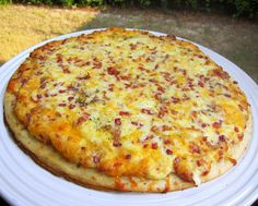 Breakfast Pizza  The original recipe is served at Chef Mickey's at Disney's Contemporary Resort.  The original recipe was just a cheese breakfast pizza. This version thought it needed a little something added to it, so bacon was added.