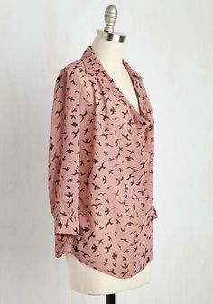 In preparation for open mic night, you don this dusty pink top and flutter to the venue. Soaring with black birds, tabbed sleeves, and a billowy collared-and-cowl neckline, this ethereal blouse is the ideal ensemble to inspire you onstage and help your original song take flight.
