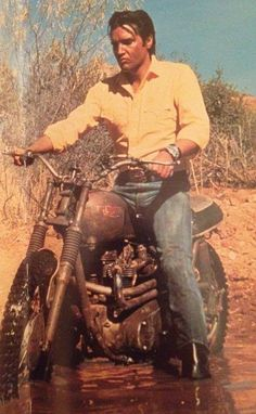 Elvis Presley on a Triumph Motorcycle ~ 1967 on the set of'Stay Away, Joe'