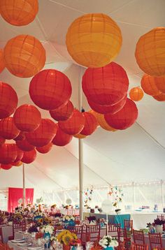 Large paper lanterns in warm colours are perfect for ultra high marquee styles such a circus or tipi tents.