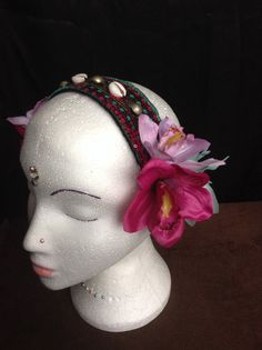Headdress has three orchids at each end of a sequinned band, which catches the light beautifully, band has a row of cowrie shells and Turkoman