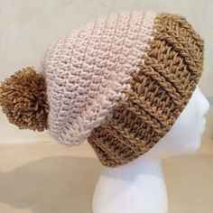 The Tykota Hat is a simple slouch hat that can be made all one color, or with one color for the body of the hat and another color for the brim. You can also make it with a pom or without. It looks great either way.
