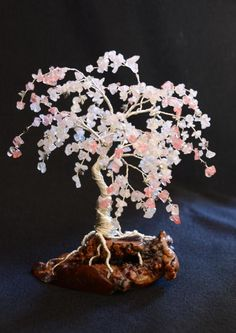 Petite Cherry Blossom tree made with 24 and 26g wire and 2 types of stone with 2 shades of each stone type (4 different stones in all). Would love to do similar copying our tree out front with all the very cool splits and twists.