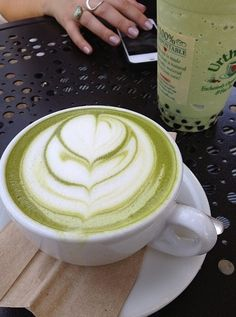 Matcha  Latte with Soy milk -   1/4 cup boiling water    - 1 tsp macha green tea powder    - 3/4 cup soy milk