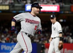 Wild Card Game, October 3, 2017: Minnesota Twins' Brian Dozier runs past New York Yankees third baseman Todd Frazier after hitting a home run during the first inning of the American League wild-card baseball playoff game Tuesday, Oct. 3, 2017, in New York. (AP Photo/Frank Franklin II)