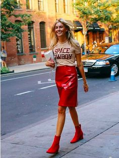 How to copy 7 of the best fashion blogger outfits from New York Fashion Week: go bold in a pair of red boots