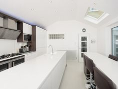 Milligan and Jessop designed and installed this modern handleless kitchen, more photos here - http://www.sncollection.co.uk/real-kitchens/real-kitchen-projects/remo-gloss-white-milligan-jessop.html