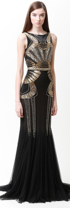 Awesome, unique embellished gown - i'd definitely be smiling a little more if i was wearing this beauty :P