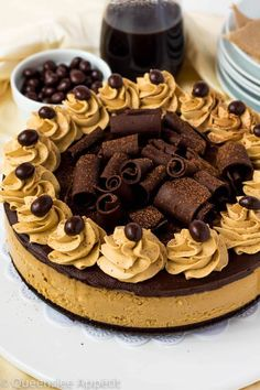 This Coffee Brownie Cheesecake consists of a creamy coffee cheesecake sitting on top of a dense brownie bottom, topped with a rich coffee chocolate ganache, chocolate curls, coffee whipped cream and chocolate covered coffee beans. Coffee Cheesecake, Cheesecake Brownies, Chocolate Cheesecake, Cheesecake Recipes, Dessert Recipes, Dishes Recipes, Drink Recipes, Chocolate Covered Espresso Beans, Chocolate Coffee