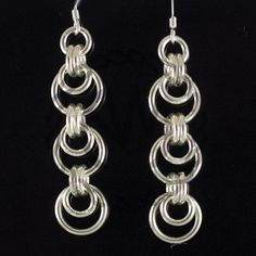 Chain Maille Earrings  Add beads? Different colours of jump rings? Def. gotta play on this design!