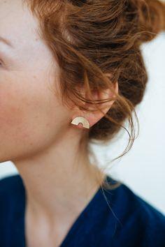 Rise earrings via Kiki Koyote - Hand Cut brass with sterling silver posts.