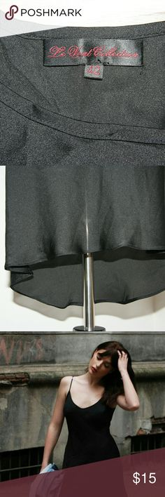 NWOT Black Slip size 42 (US size 12) NWOT Black Slip  size 42 (US size 12) Black Adjustable straps New, never worn Intimates & Sleepwear Chemises & Slips