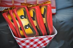 Lego Ninjago party favors.....print Ninjago eyes from Google images and wrap around candy bars
