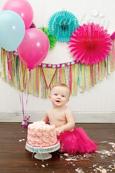 cake smash photographer in winston-salem, nc | baby photographers in high point, clemmons, greensboro | birthday photography and one year mini sessions | colorful hot pink fuschia teal aqua theme birthday party ideas tutu flower rosette cake banner bunting
