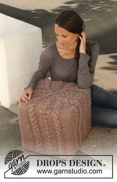 "What!!!!  amazing!  Knitted DROPS cover for pouf with cables and lace pattern in ""Eskimo"". ~ DROPS Design"