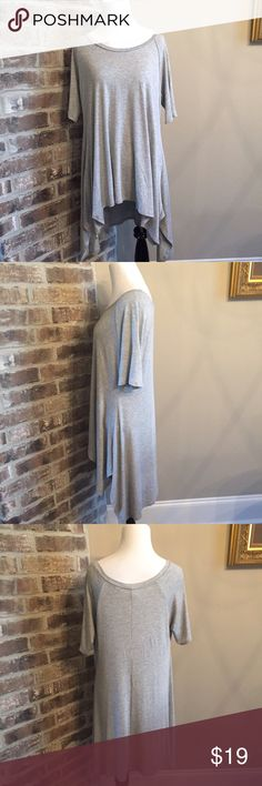NWOT Grey tunic Never worn grey tunic. Shark bite hem. Rayon/spandex blend. Made in the USA. Hand wash. Size XL but would best fit a medium/large for oversized look. cover stitch Tops Tunics