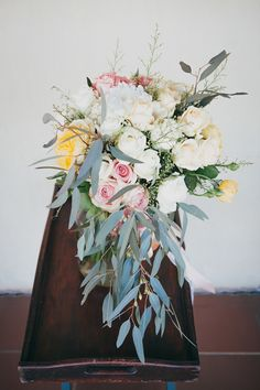 pastel wedding bouquet with eucalyptus - photo by Dearheart Photos http://ruffledblog.com/handcrafted-wedding-with-a-rabbits-and-wreaths-theme #weddingbouquet #flowers #bouquets