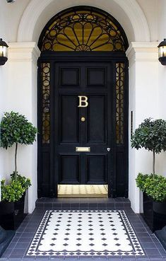 Dream house exterior - how cute is this front entry? Black front door is so classic and dramatic. Add a polished brass hardware package and kick plate, really make it POP with oversized planters, a monogrammed door decal, and area rug tile pattern. Front Door Entrance, Front Entrances, House Entrance, Front Entry, Entry Doors, Doorway, Grand Entrance, Entrance Rug, Entry Rug
