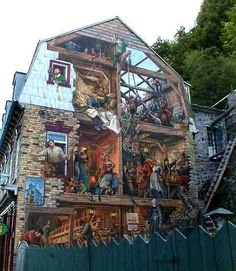 three dimensional mural on old building wall