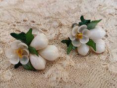 Vintage 50s Sea Shell Flower Earrings....screw on backs by BohoChicVintage on Etsy https://www.etsy.com/listing/204030055/vintage-50s-sea-shell-flower