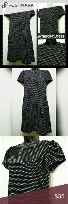 ANTHROPOLOGIE Dress Amazing ANTHROPOLOGIE Dress. Black and white. Lined. Textured fabric. Size X-small.  Approximate measurements of the dress are Shoulder 14 inches, Bust 19 inches, Length 35 inches, and Sleeve Length 7 inches. Excellent condition. Bundle multiple purchases to avail discounts and save on shipping. Anthropologie Dresses