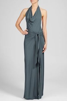A fun and flirty cowl draped halter dress with a sultry slit to show off a little leg. Dress features a knotted waist, creating a sarong-inspired profile with sophisticated appeal.