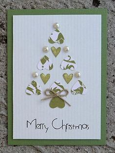 Homemade Christmas Card I like the idea of the heart shapes coming together to make this tree shape Would adapt it quite a lot but has great potential Homemade Christmas Cards, Christmas Cards To Make, Homemade Cards, Holiday Cards, Christmas Diy, Christmas Design, Recycled Christmas Cards, Bubble Christmas, Irish Christmas