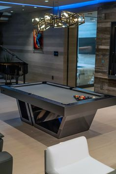 This is Titan - one of our most popular pool tables. In Greek mythology, the Titans were divine beings who came from the Gods themselves. The artful expression of the Titan modern pool table is evocative of the power and immortality of these deities. The sleek profile of this design is redolent of a strong and substantial masterpiece. #moderndesign #mancave #interiordesign #LuxuryFurniture #Design #CoolTable #GameRoom #LuxuryLiving #LuxuryLifestyle #ContemporaryDesign #Pooltable