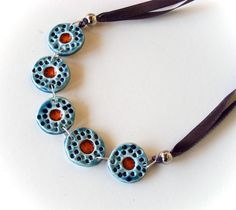 An amazing modern handmade statement necklace. In shades of blue and red, elegant and weightless...wonderful!