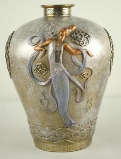 SEVENARTS ERTE BRONZE FIGURAL VASE depicting two deco-style beauties with design elements in relief, in primarily silver, gold and copper tones, marked Erte Sevenarts 1990 132/395, 11.5in.