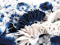 Shibori ~ three stages: 1) bound, not yet dyed; 2) dyed, still bound, and 3) unbound piece, showing indigo dyed sections and white areas that were bound while dyeing