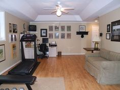 Home gym and uncluttered hangout space in the finished basement
