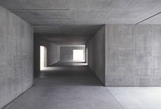 Kirchner Museum by Swiss architects Gigon & Guyer. Mono-material, all-concrete interior. Grey.