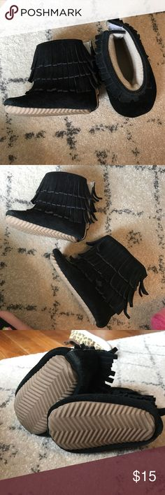Real leather fringe boots. ADORABLE fleece lined, real leather handmade boots. Worn only a few times because my daughter out grew them quickly. Velco back. Wonderful shoes for winter to keep their little baby toes warm. Is a 12mo shoe. (I'm not sure on proper sizing chart lol) Shoes Boots