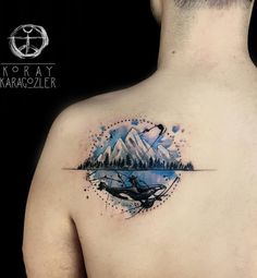 This wonderful back tattoo shows two great elements in nature. Mountains for strength and endurance and whale for peacefulness. And it's pretty much a work of art.