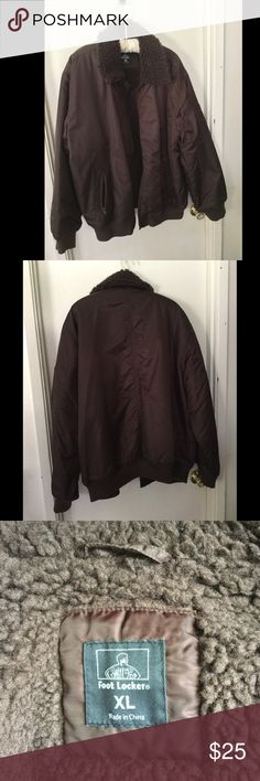Men's Nylon Jacket Men's nylon jacket with foe fur around the neck. Size medium. Brand: Footlocker Elastic bands on the arms and waste. Used and in excellent condition. Foot Locker Jackets & Coats