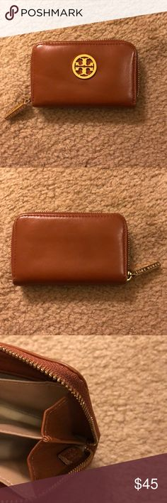 Tory Burch wallet It had a keychain on the inside but I cut it off. Some scuffs and scratches but in good used condition. Holds credit cards and some bills. I used this in my small cross body bag often. Tory Burch Bags Wallets