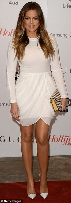 Radiant: Meanwhile, Kim's sister Khloe was radiant in a white mini dress    79      21