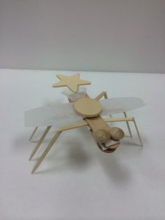 Wood and Vellum bug made in Doodle Art & Design class.