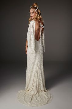 Comet from Rue de Seine wedding dresses 2016 - Form fitted silhouette with a slight train. Plunging low back line with tie's. Cape sleeves. Beaded lace throughout the dress- see the rest of the collection on www.onefabday.com