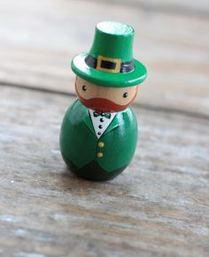 Peg dolls make a great gifts for holiday decorating or dollhouse play, hung as ornaments, or for topping cakes! Display on a shelf or curio cabinet, and switch figurines out for the seasons! Our leprechaun doll is hand painted in various shades of green, with gold hat buckle and