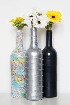 Silver futuristic wine bottle, collages map bottle, and striped black bottle. Check out the full blog post at: http://karenkavett.com/blog/886/silver-wine-bottle.php